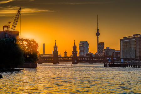 mauer: Classic view of Berlin skyline with Spree river and Oberbaum Bridge in beautiful golden evening light at sunset in summer, Germany
