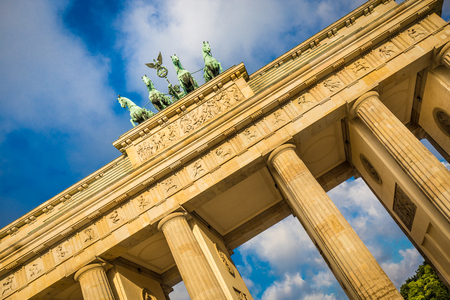 mauer: Famous Brandenburger Tor (Brandenburg Gate), one of the best-known landmarks and national symbols of Germany, in beautiful golden morning light at sunrise, Berlin, Germany