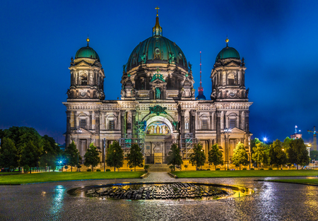 Berlin Cathedral with famous TV tower in the background in twilight during blue hour at dusk, Berlin Mitte district, Germany