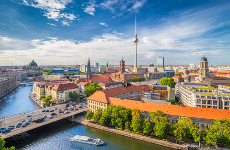 Aerial view of Berlin skyline with famous TV tower and Spree river on a beautiful day with blue sky and clouds in summer, Germany Stock Photo