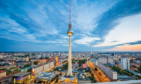 Aerial view of Berlin skyline with famous TV tower at Alexanderplatz and dramatic cloudscape in twilight during blue hour at dusk, Germany