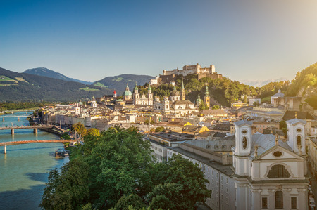 wolfgang: Aerial view of the historic city of Salzburg with famous Hohensalzburg Fortress and beautiful Salzach river on a sunny day with clouds and blue sky in summer, Salzburger Land, Austria