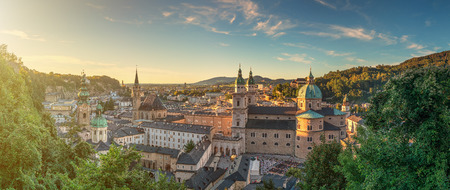 wolfgang: Panoramic view of the historic city of Salzburg with beautiful Salzach river from famous Hohensalzburg Fortress in golden evening light at sunset in summer, Salzburger Land, Austria Stock Photo