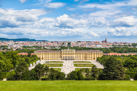 Classic view of famous Schonbrunn Palace with scenic Great Parterre garden on a beautiful sunny day with blue sky and clouds in summer, Vienna, Austria Publikacyjne