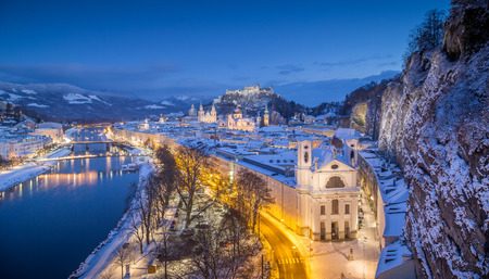 wolfgang: Classic view of the historic city of Salzburg with famous Festung Hohensalzburg and Salzach river illuminated in beautiful twilight during scenic Christmas time in winter, Salzburger Land, Austria
