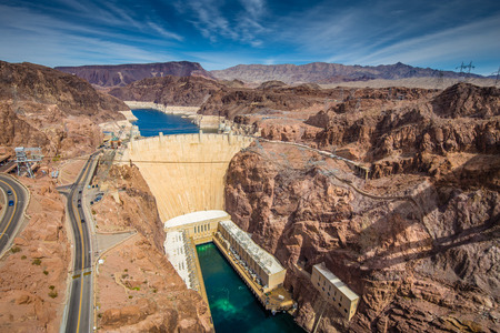 Aerial wide angle view of famous Hoover Dam, a major tourist attraction located on the border between the states of Nevada and Arizona, on a beautiful sunny day with blue sky and clouds in summer, USA Reklamní fotografie