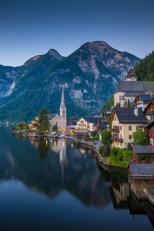 Scenic picture-postcard view of famous historic Hallstatt mountain village with Hallstattersee in the Austrian Alps in mystic twilight during blue hour at dawn in summer, Salzkammergut region, Austria Reklamní fotografie