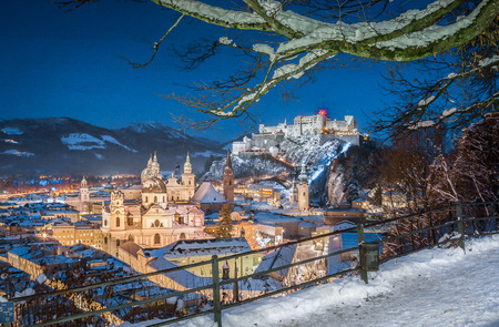 Classic view of the historic city of Salzburg with Salzburg Cathedral and famous Festung Hohensalzburg illuminated in beautiful twilight during Christmas time in winter, Salzburger Land, Austria Stock Photo