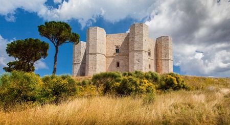 Panoramic view of famous Castel del Monte, the historic castle built in an octagonal shape by the Holy Roman Emperor Frederick II in the 13th century in Apulia, southeast Italy Stock Photo