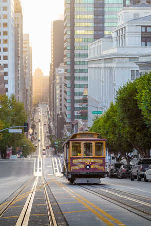 Classic view of historic Cable Car riding on famous California Street in beautiful golden morning light at sunrise in summer, San Francisco, California, USA Foto de archivo