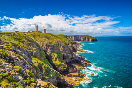Panoramic view of scenic coastal landscape with traditional lighthouse at famous Cap Frehel peninsula on the Cote dEmeraude, commune of Plevenon, Cotes-dArmor, Bretagne, northern France Stock Photo
