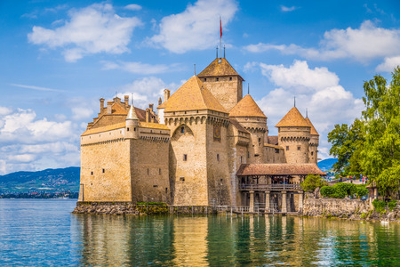 Classic view of famous Chateau de Chillon at beautiful Lake Geneva, one of Switzerlands major tourist attractions and most visited castles in Europe, Canton of Vaud, Switzerland