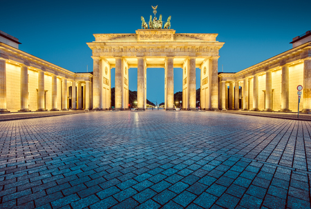 mauer: Panoramic view of famous Brandenburger Tor (Brandenburg Gate), one of the best-known landmarks and national symbols of Germany, in twilight during blue hour at dawn, Berlin, Germany