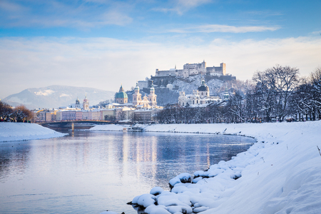 wolfgang: Classic view of the historic city of Salzburg with Salzach river on a beautiful cold sunny day with blue sky and clouds in winter, Salzburger Land, Austria Stock Photo