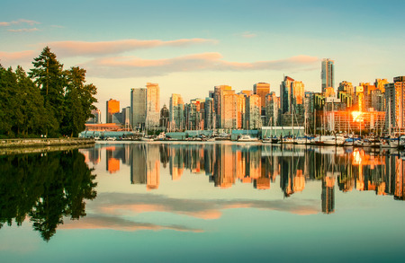 Beautiful view of Vancouver skyline with Stanley Park at sunset, British Columbia, Canada