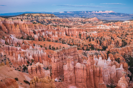 Classic view of Bryce Canyon National Park in beautiful golden evening light at sunset with blue sky and dramatic clouds seen from famous Sunset Point in summer, Utah, American Southwest, USA