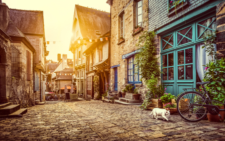 Old town in Europe at sunset with retro vintage Instagram style filter and lens flare effect 스톡 콘텐츠