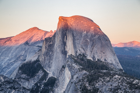Classic view of famous Half Dome illuminated in beautiful golden evening light at sunset on  a beautiful sunny day with blue sky in summer, Yosemite National Park, California, USA