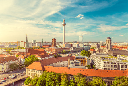 Aerial view of Berlin skyline with famous TV tower and Spree river on a beautiful day with blue sky and clouds with retro vintage filter effect, Germany
