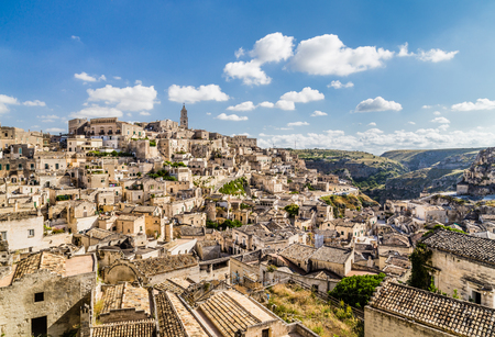 Ancient town of Matera (Sassi di Matera), European Capital of Culture 2019, in beautiful golden morning light at sunrise with blue sky and clouds, Basilicata, southern Italy