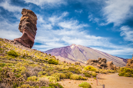 Panoramic view of unique Roque Cinchado unique rock formation with famous Pico del Teide mountain volcano summit in the background on a sunny day, Teide National Park, Tenerife, Canary Islands, Spain Stock Photo