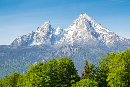 Closeup view of famous Watzmann mountain peak on a beautiful sunny day with blue sky and clouds in summer, Nationalpark Berchtesgadener Land, Bavaria, Germany