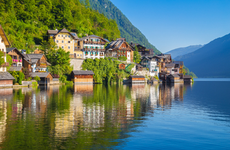 austrian village: Scenic picture-postcard view of traditional old wooden houses in famous Hallstatt mountain village at Hallstattersee lake in the Austrian Alps in summer, region of Salzkammergut, Austria