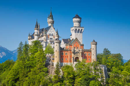 ludwig: Beautiful view of world-famous Neuschwanstein Castle, the nineteenth-century Romanesque Revival palace built for King Ludwig II on a rugged cliff, with scenic mountain landscape near F�¼ssen, southwest Bavaria, Germany