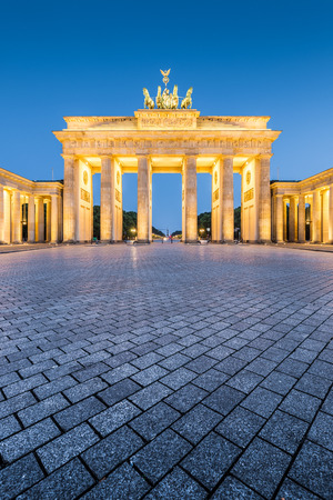Classic vertical view of historic Brandenburg Gate, Germanys most famous landmark and a national symbol, in post sunset twilight during blue hour at dusk in summer, central Berlin, Germany Stock Photo
