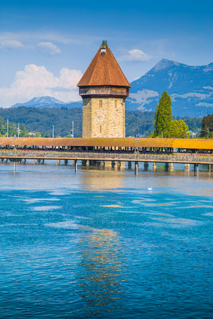 Historic city center of Lucerne with famous Chapel Bridge, the citys symbol and one of the Switzerlands main tourist attractions on a sunny day in summer, Canton of Lucerne, Switzerland Stock Photo
