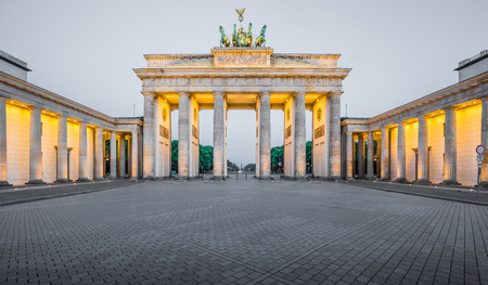 Classic panoramic view of historic Brandenburg Gate, Germanys most famous landmark and a national symbol, in post sunset twilight during blue hour at dusk in summer, central Berlin, Germany