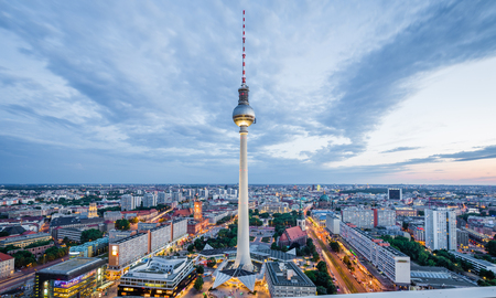 Aerial view of Berlin skyline with famous TV tower at Alexanderplatz and dramatic cloudscape in twilight during blue hour at dusk with retro vintage VSCO  style filter effect, Germany Standard-Bild