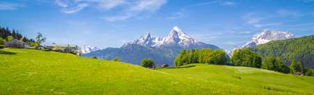 Panoramic view of idyllic mountain scenery in the Alps with fresh green meadows in bloom on a beautiful sunny day in springtime, National Park Berchtesgadener Land, Bavaria, Germany Stock fotó - 80060330