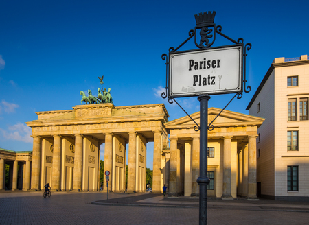 Pariser Platz with famous Brandenburger Tor (Brandenburg Gate), one of the best-known landmarks and national symbols of Germany, in beautiful golden morning light at sunrise, Berlin, Germany Stock Photo