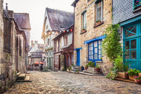Panoramic view of a charming street scene in an old town in Europe in beautiful evening light at sunset