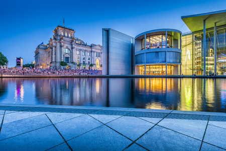 Panoramic view of Regierungsviertel (government district) with famous Reichstag building and Paul Lobe Haus (Deutscher Bundestag) at dusk, Berlin, Germany