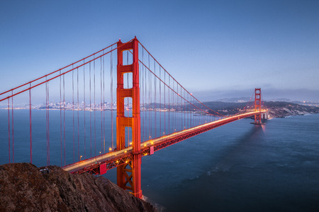 Classic panoramic view of famous Golden Gate Bridge seen from Battery Spencer viewpoint in beautiful post sunset twilight during blue hour at dusk in summer, San Francisco, California, USA Stok Fotoğraf