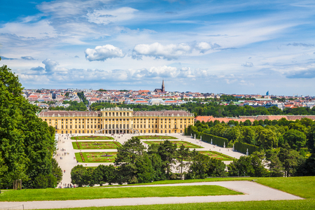 Classic view of famous Schonbrunn Palace with scenic Great Parterre garden on a beautiful sunny day with blue sky and clouds in summer, Vienna, Austria Editorial
