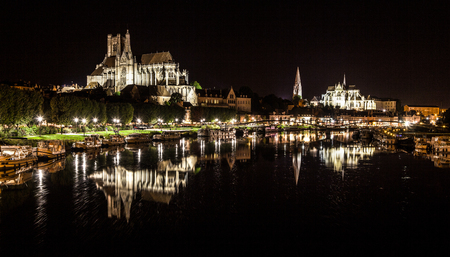Beautiful view of the historic town of Auxerre reflecting in Yonne river at night, Burgundy, France