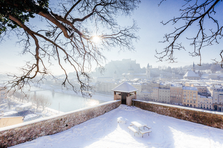 Classic view of the historic city of Salzburg with famous Hohensalzburg Fortress and Salzach river in scenic morning light at sunrise on a beautiful cold sunny day in winter, Salzburger Land, Austria Editorial