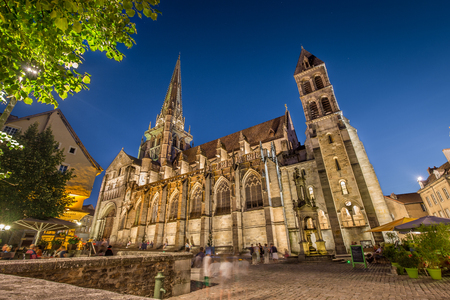 Historic town of Autun with famous Cathedral Saint-Lazare d'Autun illuminated in beautiful twilight during blue hour at dusk, Saone-et-Loire department, Burgundy, France Standard-Bild - 94490141