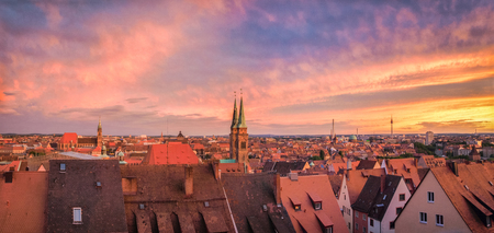 Panoramic view of the historic city of Nuremberg illuminated in beautiful golden evening light with dramatic clouds at sunset in summer, Mittelfranken region, Bavaria, Germany