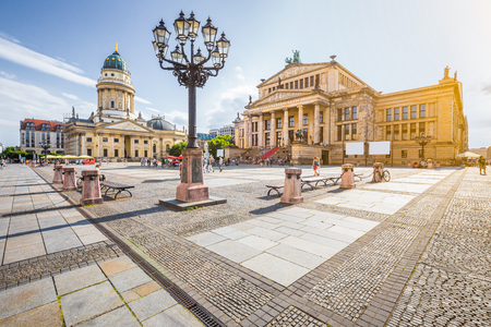 Panoramic view of famous Gendarmenmarkt square with Berlin Concert Hall and German Cathedral in golden evening light at sunset with blue sky and clouds in summer, Berlin Mitte district, Germany Banque d'images