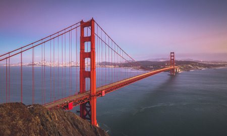 Classic panoramic view of famous Golden Gate Bridge seen from Battery Spencer viewpoint in beautiful post sunset twilight during blue hour at dusk in summer, San Francisco, California, USA Banque d'images