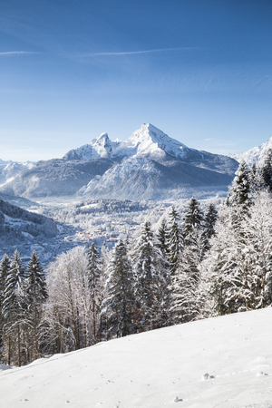 Vertical view of beautiful winter wonderland scenery with the historic town of Berchtesgaden and scenic Watzmann mountain in the Alps, Bavaria, Germany