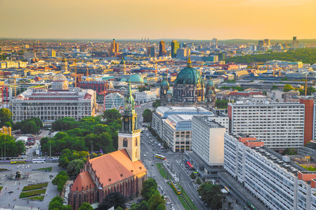 Aerial view of Berlin skyline with Marienkirche and famous Berlin Cathedral in beautiful golden evening light with clouds at sunset Éditoriale