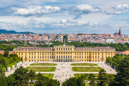 Classic view of famous Schonbrunn Palace with scenic Great Parterre garden on a beautiful sunny day with blue sky and clouds in summer, Vienna, Austria 報道画像
