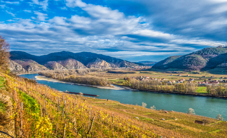 Classic panoramic view of beautiful Wachau Valley with famous Danube river and the town of Durnstein in beautiful golden evening light at sunset in summer, Lower Austria region, Austria Stock Photo