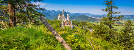 Beautiful view of world-famous Neuschwanstein Castle, the nineteenth-century Romanesque Revival palace built for King Ludwig II on a rugged cliff, with scenic mountain landscape near Füssen, southwest Bavaria, Germany