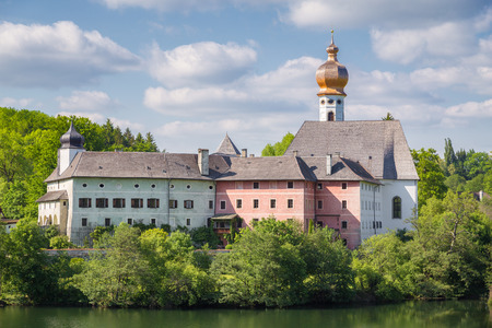 Classic panoramic view of famous Augustinian Cloister of Hoglworth on a beautiful sunny day with blue sky and clouds in summer, Berchtesgadener Land, Bavaria, Germany